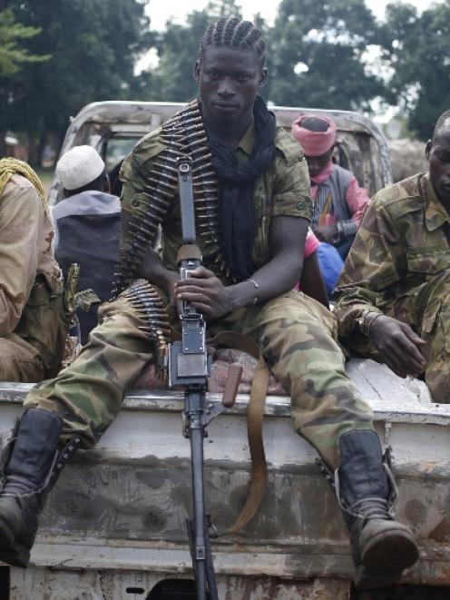 Seleka fighters take a break as they sit on a pick-up truck in the town of Goya. Photo by Reuters