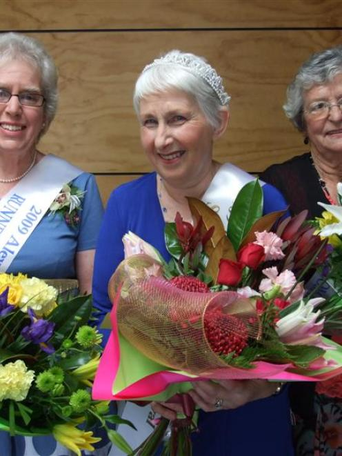 Senior Blossom Festival Queen Jennifer Bowie, of Alexandra (centre), is flanked by the two...