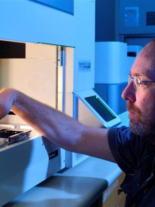 Sequencing specialist Dr Aaron Jeffs uses powerful new genomic testing equipment at the Otago...