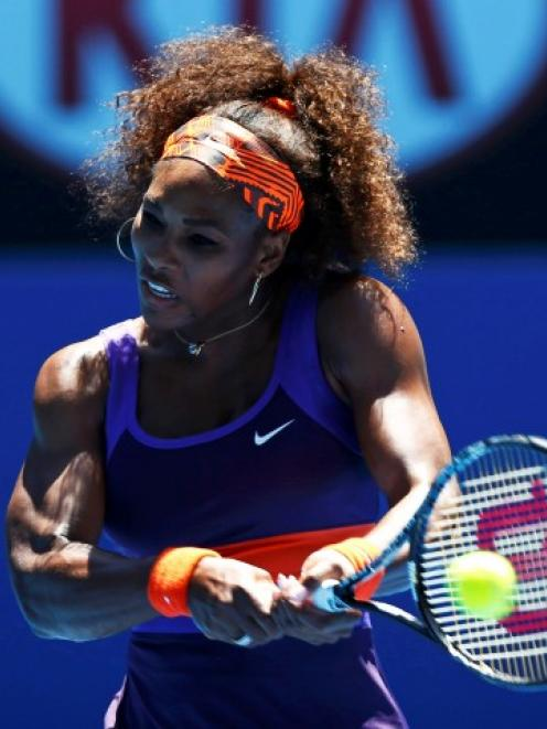Serena Williams of the US hits a return to Edina Gallovits-Hall of Romania during their women's...