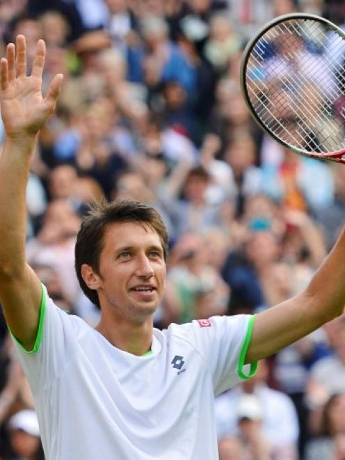 Sergiy Stakhovsky of Ukraine reacts after defeating Roger Federer of Switzerland in their men's...