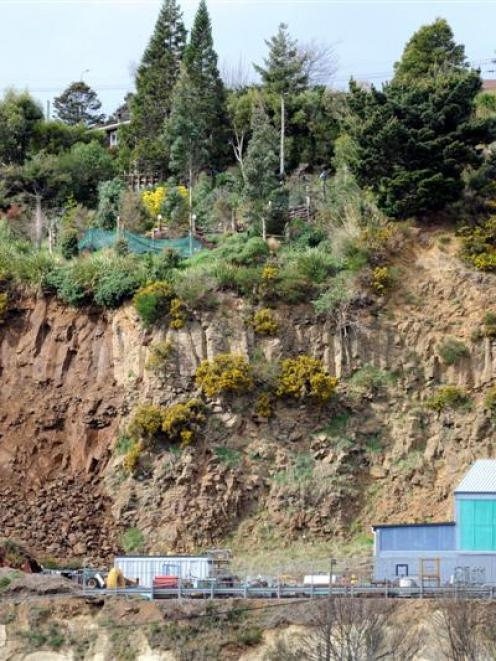 Several tonnes of soil and rock which fell 30m into an industrial machinery sales yard in Stone...