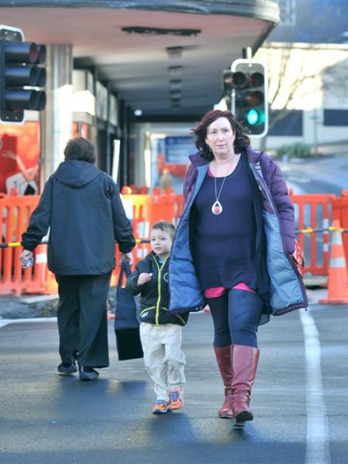 Shar Carlini and her grandson Bodie Morris (4) of Dunedin, cross Princes St at the Exchange....