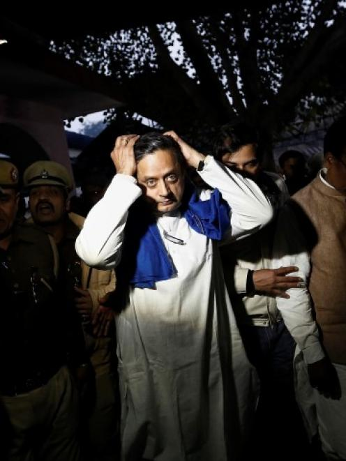Shashi Tharoor (C) gestures after performing the last rites for his wife Sunanda Puskhar at a...
