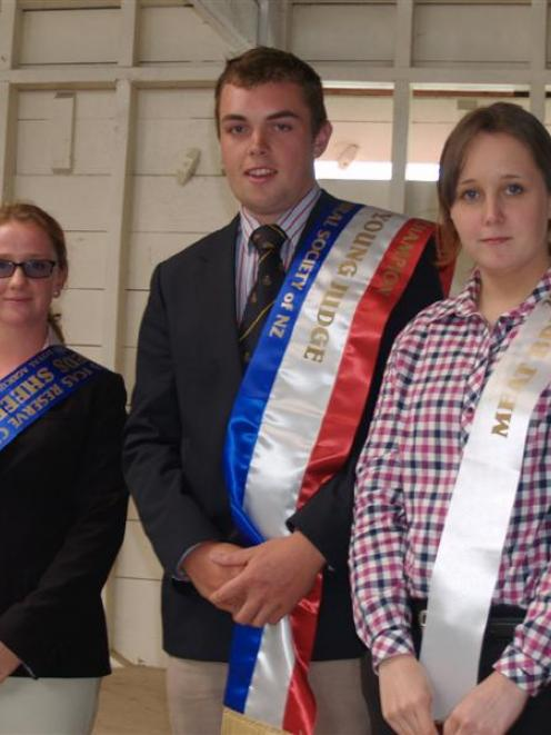 Sheep stock-judging competition winner Robert Gregory, of Gore,  is flanked by runner-up Rosa Lea...
