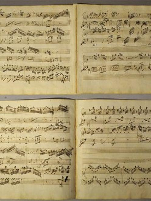 Sheet music, recently identified as part of a childhood creation by Mozart, is seen during a...