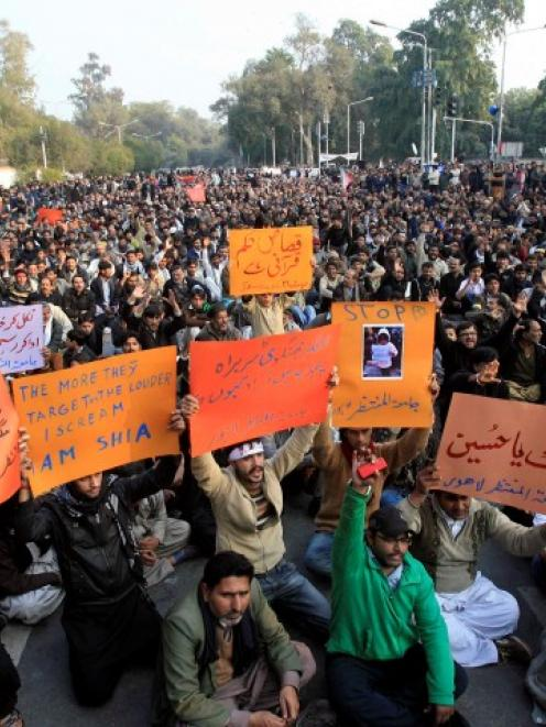 Shi'ite Muslims gather in Lahore to protest against last week's twin bomb attack in Quetta....