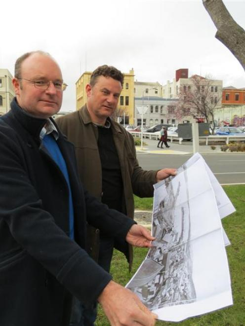 Looking over some historic photos of Dunedin are Heritage New Zealand regional archaeologist Dr...