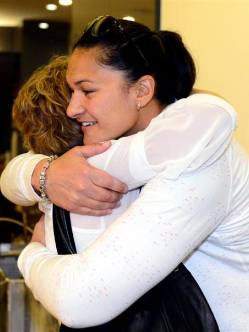 Shot put champion Valerie Adams and New Zealand team manager Raylene Bates hug in Dunedin...