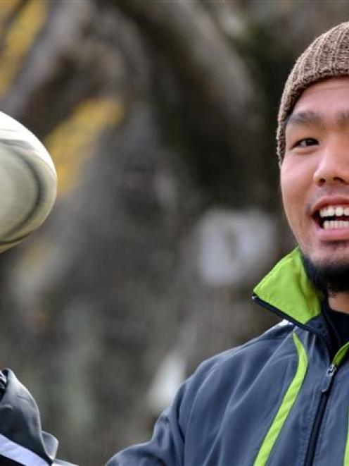 Shota Horie spins a rugby ball at Logan Park yesterday. Photo by Peter McIntosh.