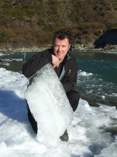 Shotover Jet operations manager Simon Thew with one of the chunks of ice which clogged the river....