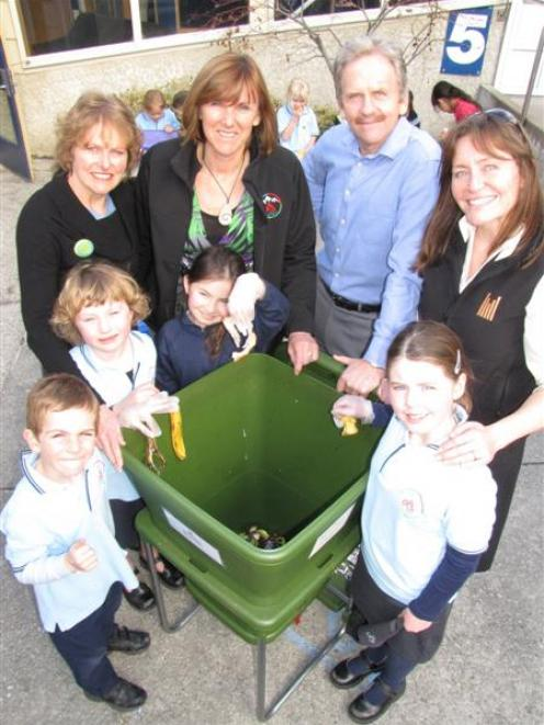 Showing how they are using the hotel's donated worm farm are Queenstown Primary School pupils ...