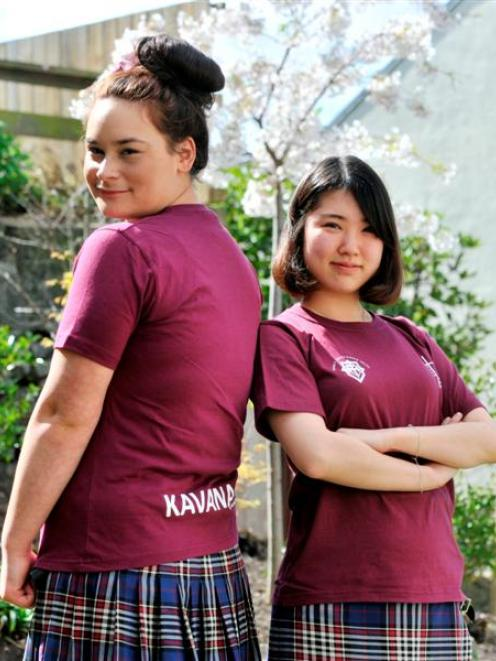 Sia Caldwell (left) and Sherry Sim model the 2013 ''Good One'' T-shirts they designed. Photo by...