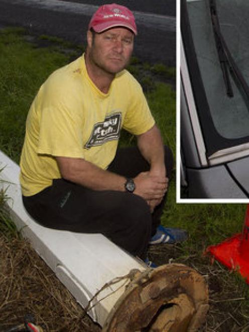 Silvio Kors feels he was lucky to escape harm when the lamp-post crashed on to his ute. Photo /...