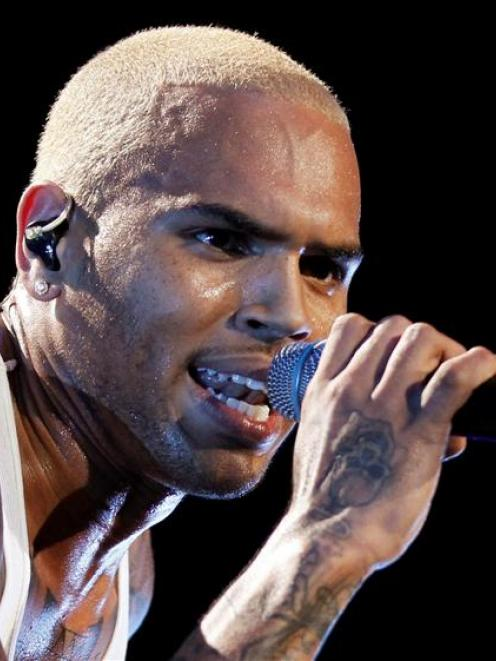 Singer Chris Brown performs in concert on this file photo. REUTERS/Danny Moloshok/Files