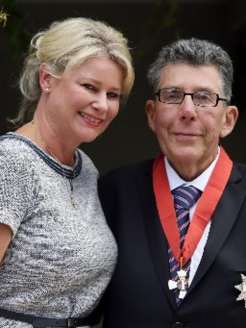 Sir Paul Holmes poses with wife Lady Deborah after receiving his knighthood earlier this month.