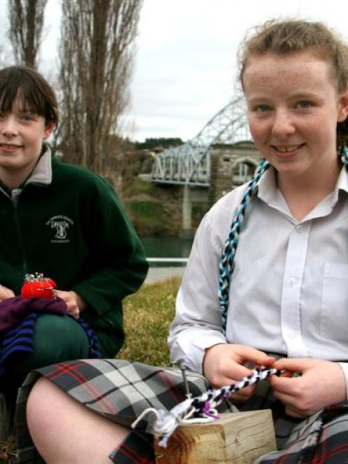 Sisters (from left) Tyla (11) and Brie (13) Davidson, of Alexandra, work with wool and merino...