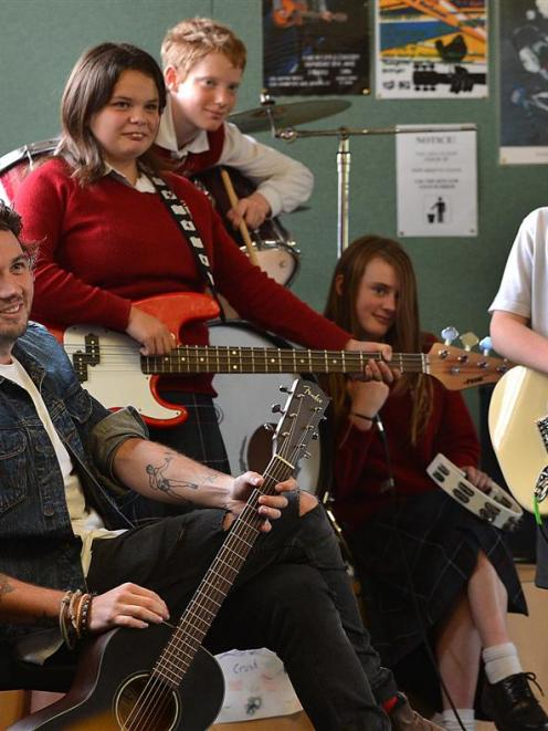 Six60 bassist and synth player Chris Mac with members of Kaikorai Valley College's Instant Crush ...