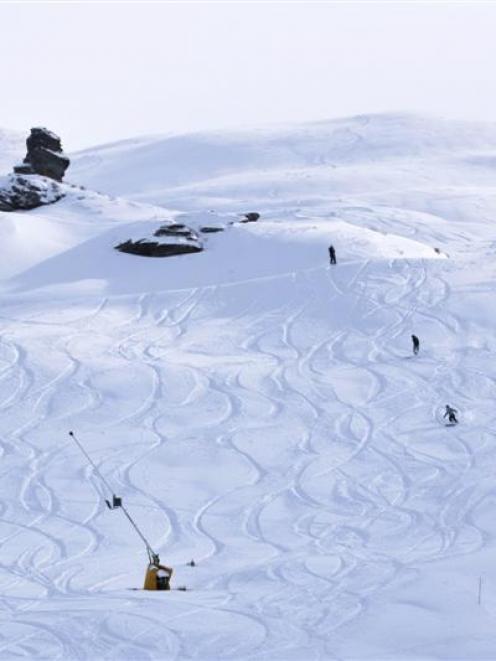 Skiers and snowboarders enjoy fresh tracks at Coronet Peak yesterday. Photo by NZSki.