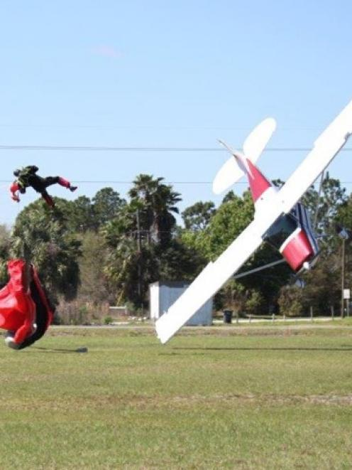 Skydiver John Frost and the Cessna piloted by Shannon Trembley about to hit the ground after...