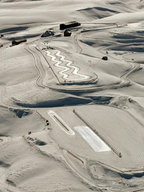 Slick ice surfaces catch the light on two of the Southern Hemisphere Proving Grounds test tracks....