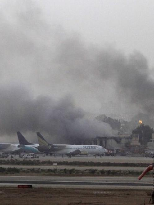 Smoke billows from Jinnah International Airport in Karachi during the attack. REUTERS/Athar Hussain