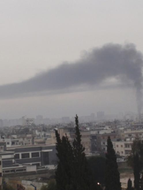 Smoke billows in Homs after Syrian President Bashar al-Assad's forces renewed their bombardment. ...