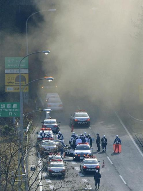 Smoke is seen from the Sasago Tunnel on the Chuo Expressway.  REUTERS/Kyodo
