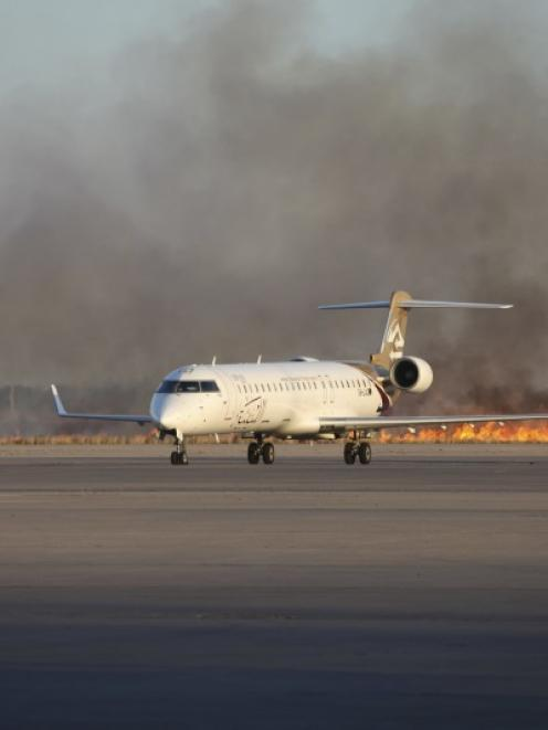 Smoke rises after a shelling at Tripoli International Airport. Photo by Reuters