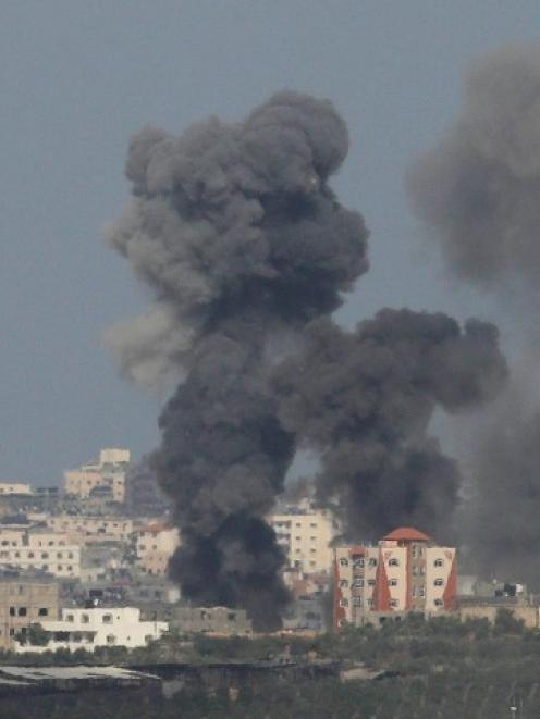 Smoke rises after an explosion in the northern Gaza Strip. REUTERS/Ammar Awad