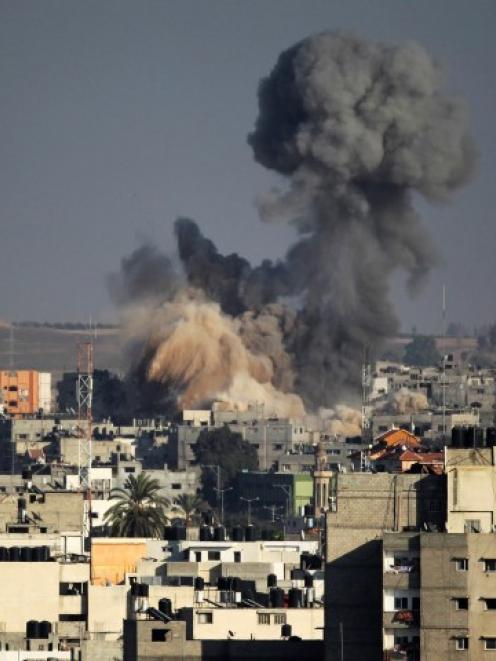 Smoke rises after an explosion in what witnesses said was an Israeli air strike in Gaza. REUTERS...