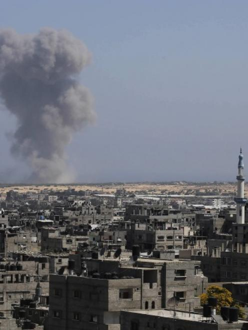 Smoke rises following what witnesses said was an Israeli air strike in Rafah in the southern Gaza...
