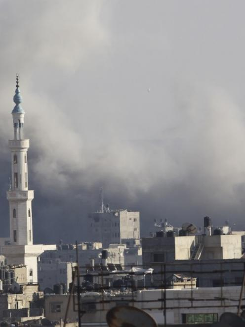 Smoke rises following what witnesses said was an Israeli air strike in Gaza City. Photo by Reuters