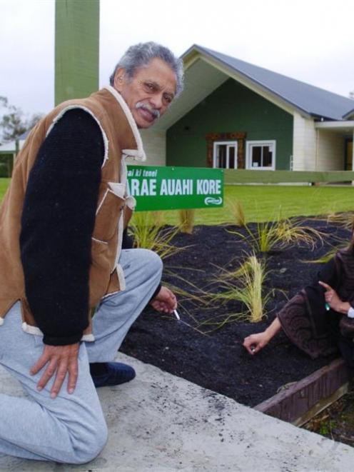 Marae kaumatua Barney Taiapa and kohanga teacher Debbie Kuiti stub out their cigarettes at the...