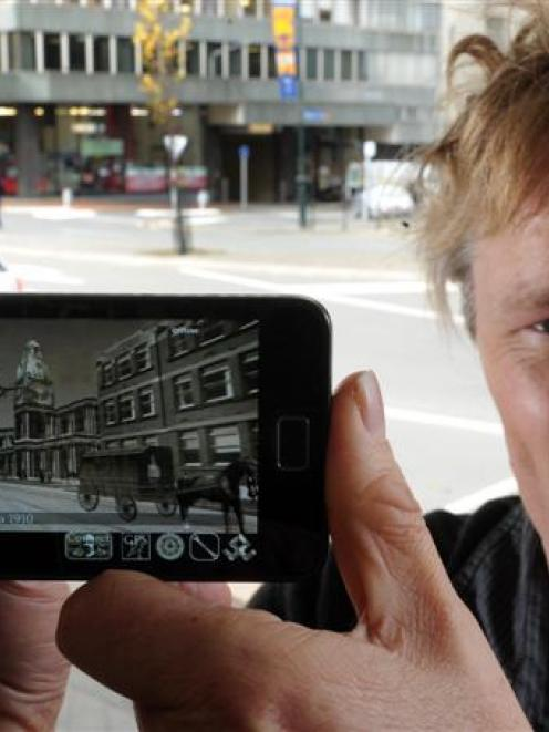 Software developer Glenn Linde displays his Android app, Dunedin, which recreates early 20th...