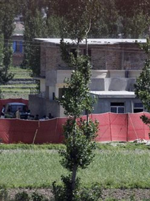 Soldiers from Pakistan's army are seen near the house in Abbottabad, Pakistan, where it is...
