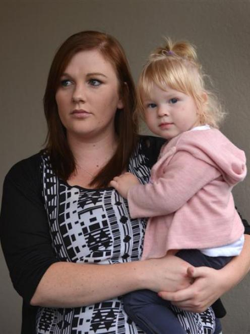 Solo mother Nikkita Burgess-Moyle,  holding her 17-month-old daughter Poppy, is disappointed with...