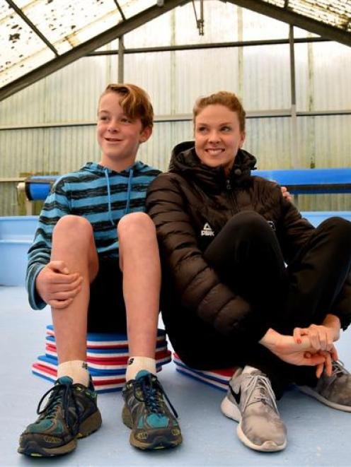 Solomon Harcombe and medal winning swimmer Lauren Boyle at the Macandrew Bay School swimming pool...