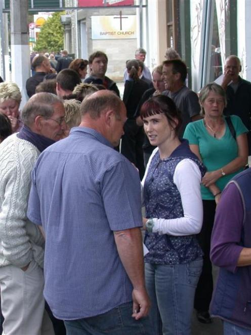 Some of Summit Wool's 315 staff discuss the outcome of a meeting with the company in Oamaru...