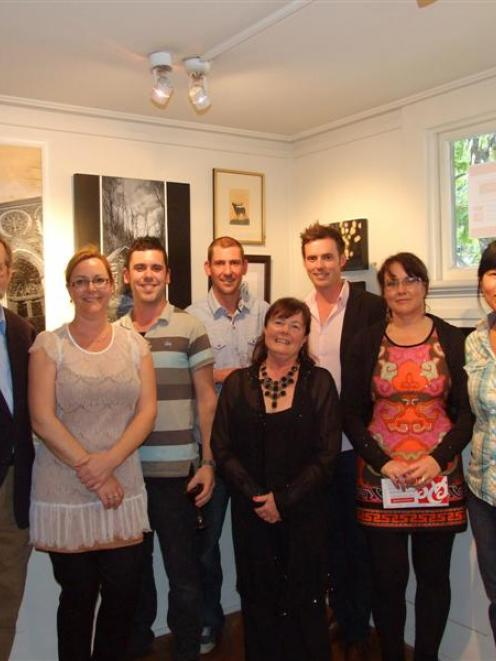 Some of the award winners with Judge Mark Moran and Queenstown Art Society president Sue Wademan....