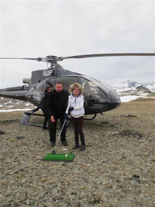 Sophie Newbold, of Gibbston, tees off on the Remarkables mountain range with Peugeot New Zealand...