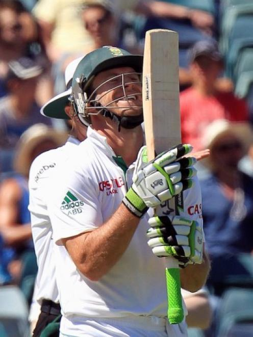 South Africa's AB de Villiers celebrates reaching a century at the WACA during the third day's...