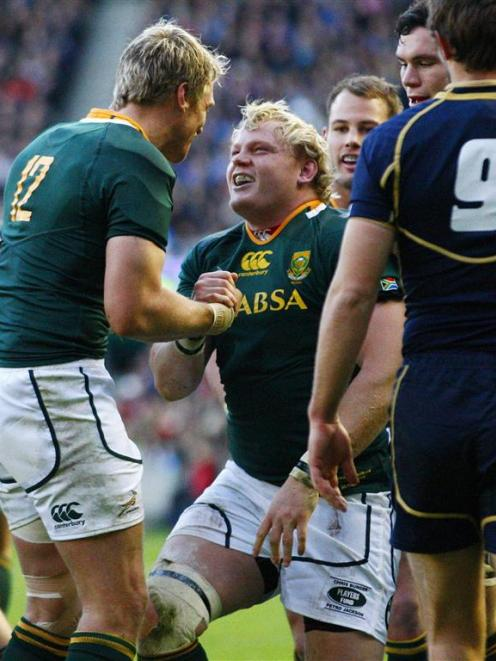 South Africa's Adriaan Strauss celebrates with Jean De Villiers after scoring his first try...