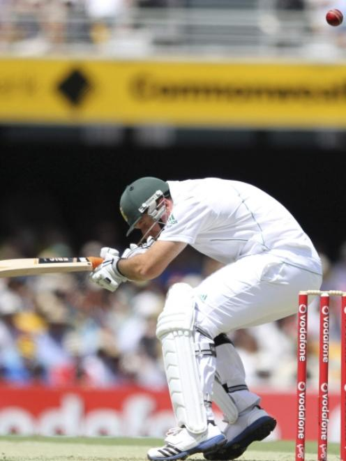 South Africa's captain Graeme Smith avoids a bouncer while batting against Australia during the...