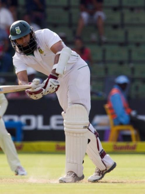 South Africa's Hashim Amla plays a shot on his way to a century day one of the second test...