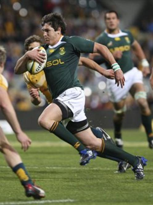South Africa's Jaque Fourie runs with a ball on his way to a try during their Tri-Nation rugby...