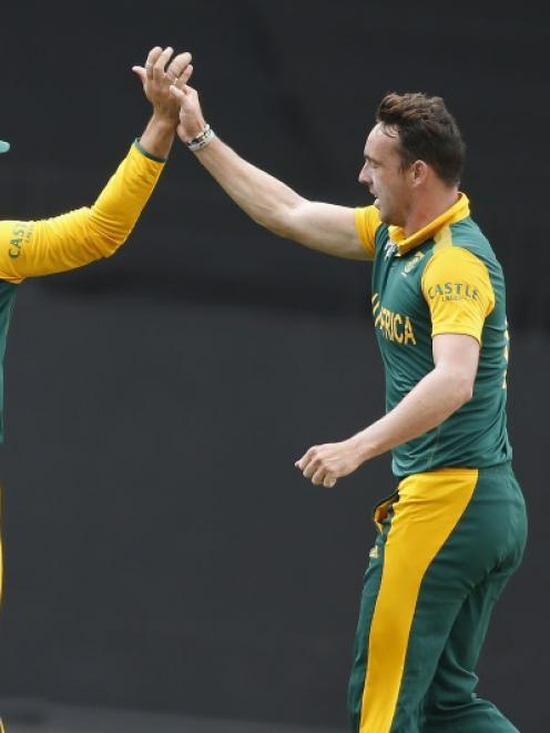 South Africa's Kyle Abbott celebrates with teammate Rilee Rossouw after dismissing Pakistan's...