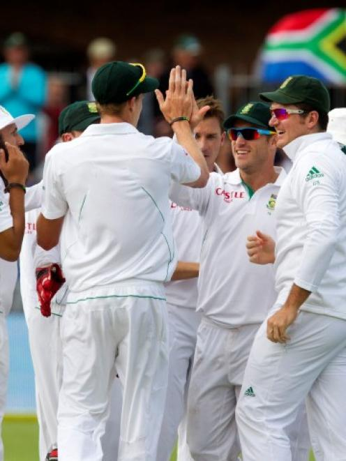South Africa's players celebrate the wicket of New Zealand's Martin Guptill on day two of the...