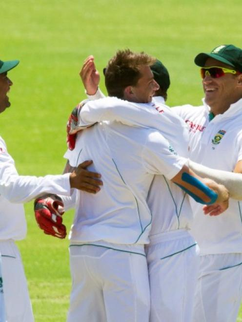 South Africa's players celebrate the wicket of New Zealand's BJ Watling on day four of their...