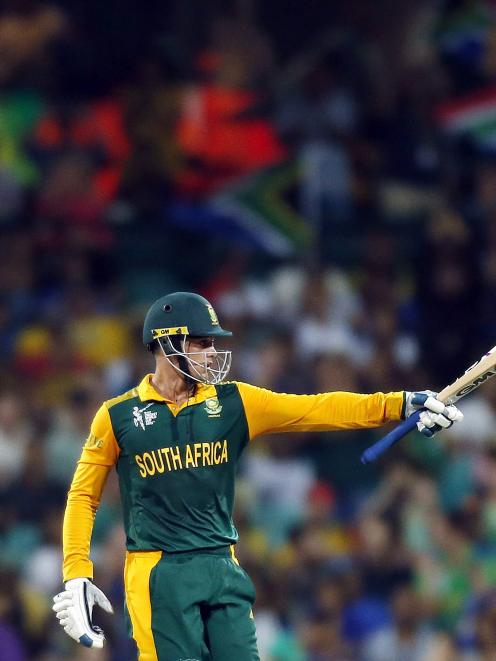 South Africa's Quinton de Kock celebrates reaching fifty runs during the Cricket World Cup...